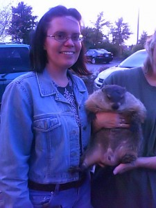 Me standing next to Hanzel the Groundhog while a PWR volunteer holds him