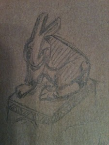 A sketch of a rabbit, done in pencil on brown paper