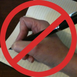 A hand holding a pen in a pincer-like grip, with a red circle and line over it