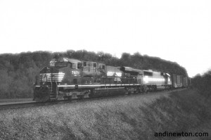a grainy black and white photo of a freight train