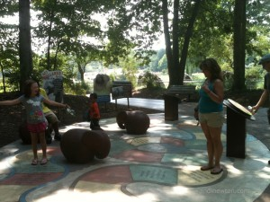 Savannah and Sam play a sidewalk boardgame at the NC Zoo