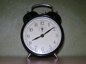 An old-style black alarm clock