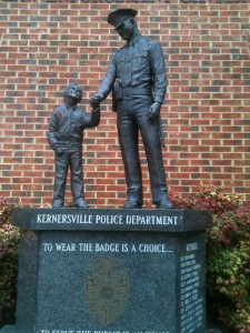 A statue of a police officer holding a little boy's hand