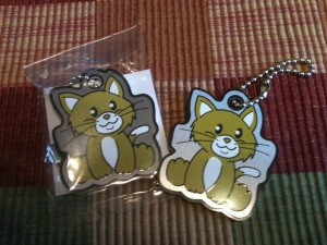 Two Cacheaddict Cachekinz kitten trackable tags