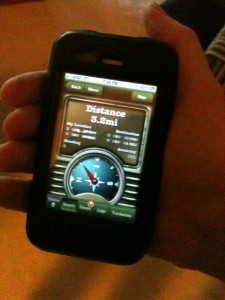 A geocaching app showing a compass on an iPhone